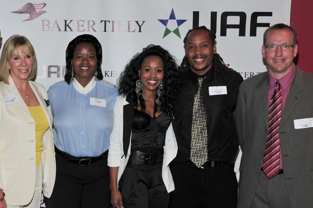 Baker Tilly's Washington, D.C. business development leader Barbara McDuffie, UAF Regional Director Rema Miller, performer SKAI, Reggie, and Baker Tilly affordable housing leader Don Bernards. The venture wants to provide financial literacy training and affordable housing throughout the nation.